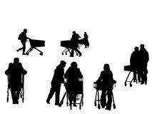 Human silhouettes  pushing  shopping carts Stock Photo