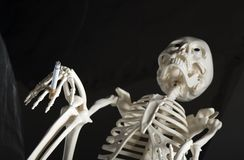 Human skeleton with cigarette Royalty Free Stock Photography