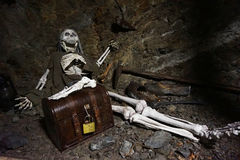 Human skeleton with golden treasure. Is waiting for the hell royalty free stock image