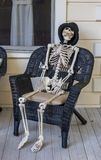 Human skeleton sitting in a chair Royalty Free Stock Photography