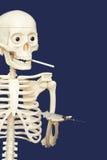 Human skeleton smoking and using drugs - death Stock Photos