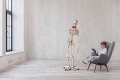 Human skeleton with a visit. To the doctor`s office royalty free stock photos