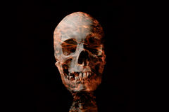 Human skull. With red tattooed effect on black background Royalty Free Stock Photography
