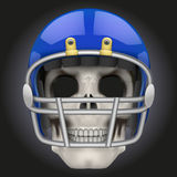 Human skull with american football player helmet. Royalty Free Stock Photography