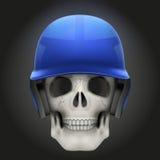 Human skull with baseball helmet Royalty Free Stock Photography