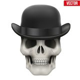Human skull with black bowler hat Stock Photo