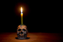 Human skull with candle Stock Photos