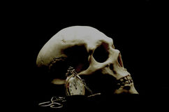 Human skull and a clock Royalty Free Stock Images