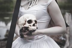Human skull in creepy bride hands. Halloween concept. Human skull in creepy dead bride hands. Halloween concept royalty free stock photo