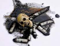 Human skull on dirty polluted water and smoked cigarettes Royalty Free Stock Image