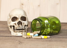 Human skull and drugs Royalty Free Stock Photography