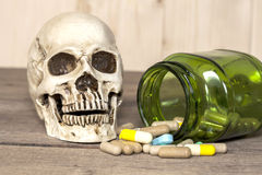 Human skull and drugs Stock Photo