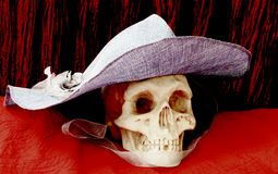 Human skull with a hat Royalty Free Stock Image