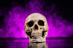 Human skull head with smoke. Old human skull head with smoke on dark background Royalty Free Stock Photo