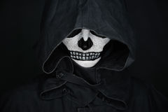Human with skull make-up in hood Stock Photography