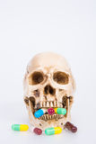 Human skull with medical drugs Stock Photography