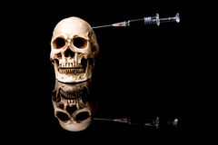 Human skull and Medical equipment Royalty Free Stock Image