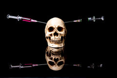 Human skull and Medical equipment Royalty Free Stock Images