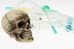 Human skull. And Medical equipment on white background Royalty Free Stock Photography