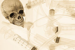 Human skull. And Medical equipment on white background Royalty Free Stock Photo