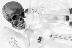 Human skull. And Medical equipment on white background Royalty Free Stock Images