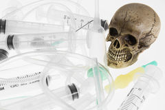 Human skull. And Medical equipment on white background Royalty Free Stock Image