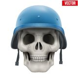 Human skull with Military United Nations helmet Royalty Free Stock Images