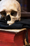 Human skull and old book Stock Photo
