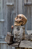 Human skull and Old Iron rests on the old wood. Royalty Free Stock Photos