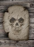 An human skull on an old papyrus Stock Photo
