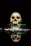 Human skull in the pile of drugs Stock Photography
