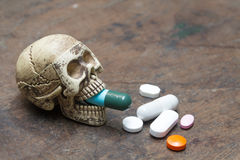 Human skull and pills on old wood background,Healthy care  conce Stock Images