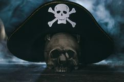 Pirate hat above a human skull. stock images