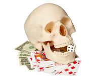 Human skull, playing cards and money Royalty Free Stock Photos