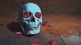 Human skull with red heart . Hearts fall on the skull slow motion. Concept for Valentine`s Day. AIDS. Human skull with red heart . Hearts fall on the skull slow stock footage