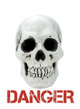 Human skull with sample text Danger Stock Images