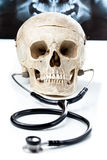 Human skull with a stethoscope. Stock Photography
