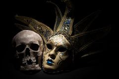 Human skull with venetian mask on a black background. Theater and drama concept Royalty Free Stock Photography