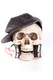 Human Skull wear black hat  listen to music by headset/headphone Royalty Free Stock Photography