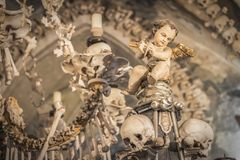 Human skulls and bones in a church in Kutna Hora. Sedlec Ossuary Czech: Kostnice in Sedci.  royalty free stock photos