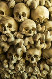 Human skulls and bones. In the wall of the Skull Chapel in Czermna, Poland stock photography