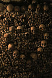 Human skulls in the catacombs of Paris. Photo taken at August 2014 Stock Photos