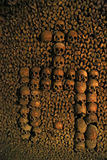 Human skulls in the catacombs of Paris. Photo taken at August 2014 Stock Photography