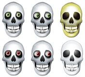 Human Skulls Clip Art. A clip art illustration featuring an assortment of 6 human skulls both haunted with creepy eyes and plain Royalty Free Stock Images