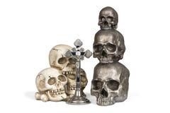 Human skulls and Crucifix Royalty Free Stock Photos