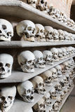 Human skulls inside a catacomb. Royalty Free Stock Photos