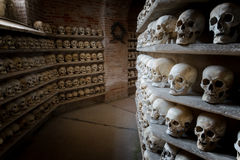 Human skulls inside a catacomb inside a catacomb Royalty Free Stock Photography