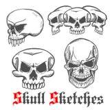 Human skulls and monster cranium sketches Stock Photo
