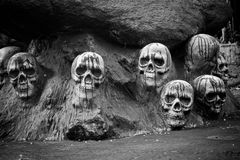 Human skulls sculpture black and white. Human skulls in stone with blood sculpture black and white Stock Image