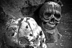 Human skulls sculpture black and white. Human skulls in stone with blood sculpture black and white Royalty Free Stock Image